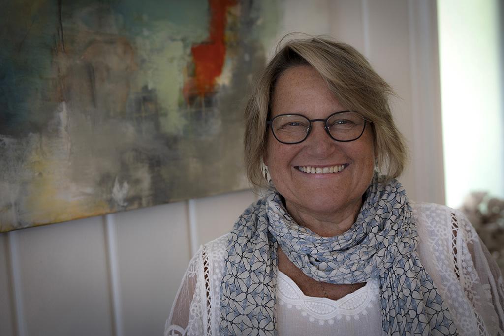 Headshot Diane Walters wearing a scarf amd white shirt
